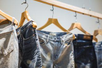Jeans hang on rack
