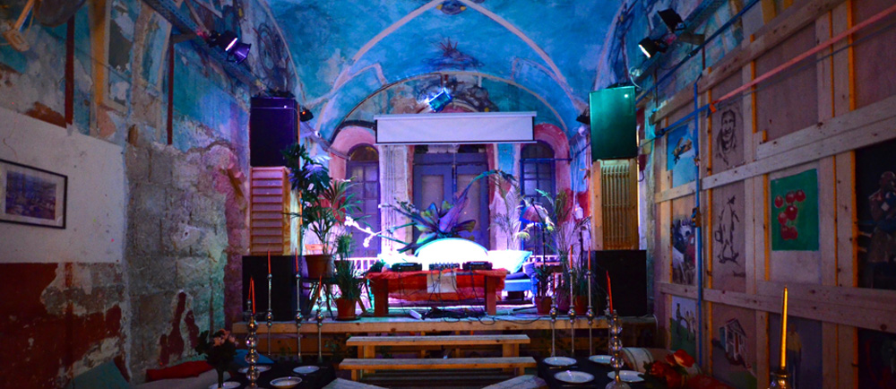 A DJ booth has been set up on stage to entertain the guests for Purim. Photo by Sarah Tietje-Mietz.