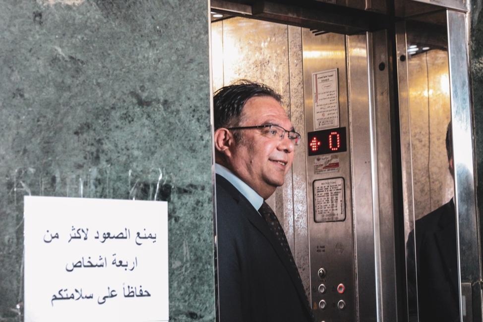 Shaddad Attili stepping out of an elevator.